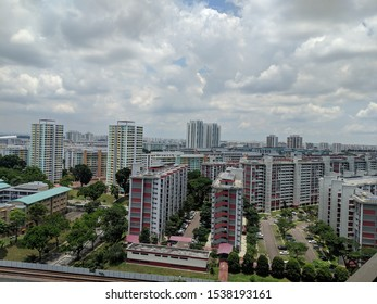Aerial panoramic view dense of HDB apartment buildings at midday in neighborhood of Singapore.