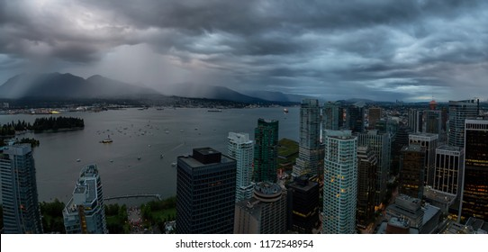 Aerial panoramic view of Downtown City during a stormy summer sunset. Taken in Vancouver, British Columbia, Canada.