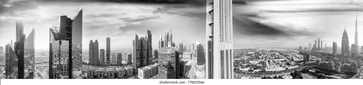 Aerial panoramic view of downtown city skyline at sunset, Dubai