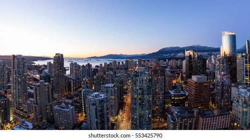 Aerial Panoramic View of Downtown Vancouver, BC, Canada. Taken during a clear sky winter sunset.