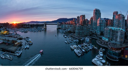 Aerial Panoramic View of Downtown Vancouver, BC, Canada around Granville Island Public Market and False Creek. Taken during a cloudy sunset.