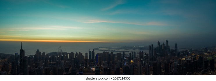 Aerial Panoramic view of Dubai bay at sunset, U.A.E.