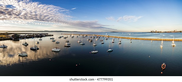 Aerial panoramic view of Edinburgh's Granton Harbour on the Firth of Forth. Scotland, UK