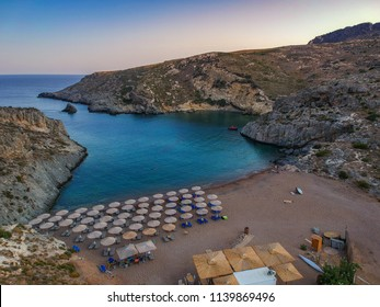 Aerial panoramic view of the famous rocky beach Melidoni. Amazing scenery with crystal clear water and a small rocky gulf in Kythira island at sunset. Mediterranean sea, Greece, Europe.