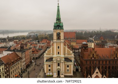 Aerial panoramic view of historical buildings, roofs and the Holy Spirit Church in Polish medieval town Torun listed on the UNESCO World Heritage Site.