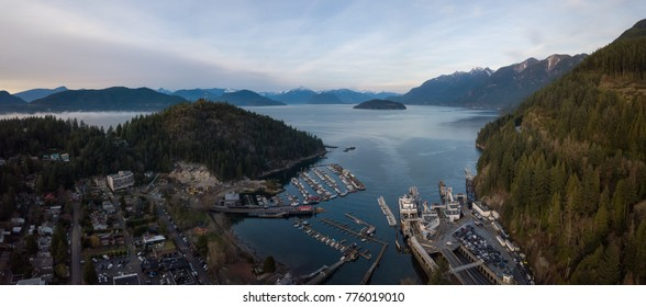 Aerial panoramic view of Horseshoe Bay and Ferry Terminal during a vibrant cloudy evening. Taken in West Vancouver, British Columbia, Canada.
