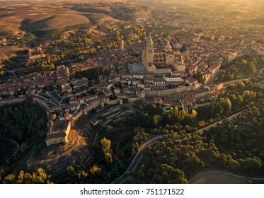 Aerial panoramic view, from a hot air balloon, from the city of Segovia, Spain. Autumn colors in the vegetation and historic buildings of the city, such as its cathedral.