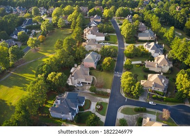 Aerial panoramic view of house cluster in a sub division in Suburbs  with golf course and lake in metro Atlanta in Georgia ,USA shot by drone shot during golden hour