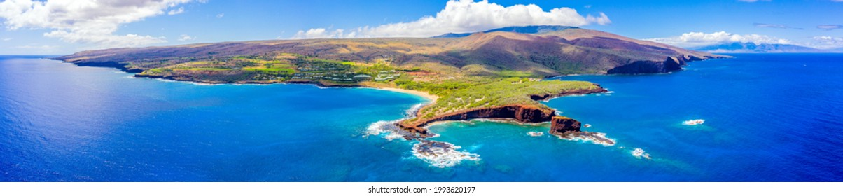 Aerial panoramic view of the island of Lanai, Hawaii, a short ferry ride from Maui, the mountains of which can be seen in the background to the right.