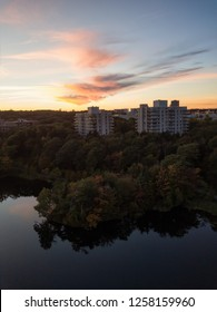 Aerial panoramic view of a Lake Banook in the Modern City during a vibrant Sunset. Taken in Halifax, Dartmouth, Nova Scotia, Canada.