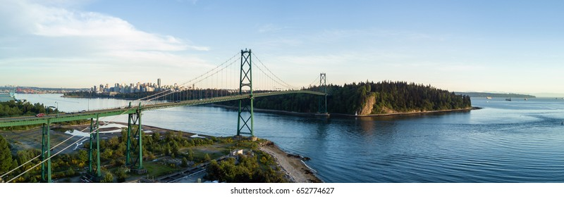 Aerial Panoramic View of Lions Gate Bridge, Stanley Park and Downtown City in the background. Taken in Vancouver, British Columbia, Canada.