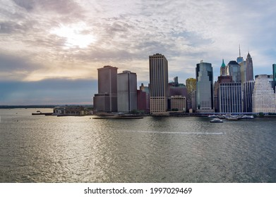 Aerial panoramic view of Lower Manhattan with water taxi boat Whitehall South Ferry Terminal, New York way from Staten Island NY NJ USA