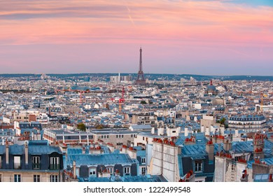 Aerial panoramic view from Montmartre over Paris roofs and Eiffel tower at nice sunrise, Paris, France