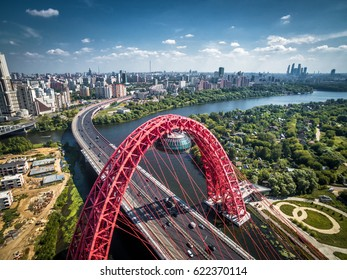 Aerial panoramic view of Moscow with a modern cable-stayed bridge, Russia. Architecture landmark of Moscow. Beautiful scenic panorama of Moscow with Moskva River. Nice Moscow skyline in summer.