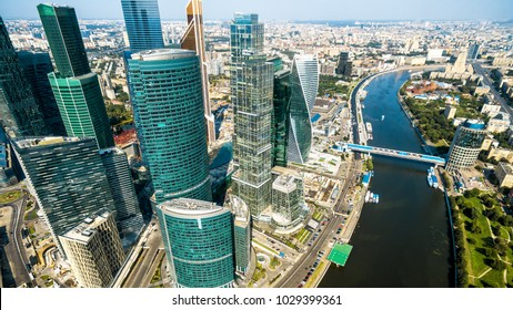 Aerial panoramic view of Moscow with Moskva River in summer, Russia. Panorama of Moscow in the sunlight. Modern skyscrapers of Moscow-City. Landscape and cityscape of Moscow. The city from above.