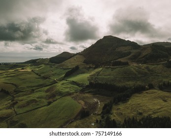 Aerial panoramic view of the nature, cliffs and fields in Sao Miguel, Azores Beautiful Portugal.