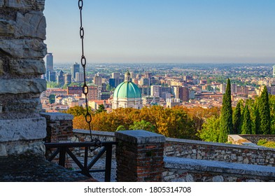 Aerial panoramic view of old historical city centre of Brescia city with Dome of Santa Maria Assunta New Cathedral, Duomo Nuovo Catholic church, Lombardy, Northern Italy. Cityscape of Brescia town.