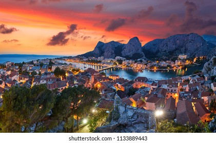 Aerial panoramic view of Old town Omis: Ancient walls and red tiled roof. Montenegro, Europe. One of best preserved medieval cities in the Mediterranean and most popular resorts of Adriatic Riviera.