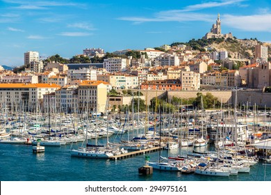 Aerial panoramic view on basilica of Notre Dame de la Garde and old port  in Marseille, France