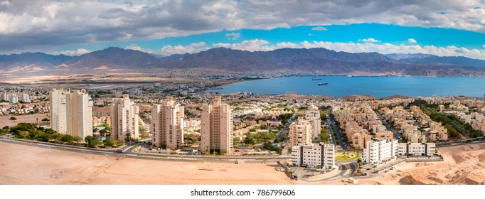Aerial panoramic view on Eilat (Israel) and Aqaba (Jordan). The images for panorama were taken from stone hills surrounding Eilat city