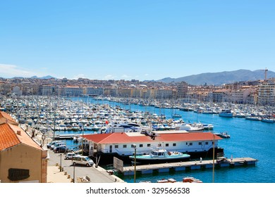 Aerial panoramic view on old port in Marseille, France. On sunny warm day in Provence.