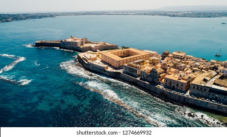 Aerial panoramic view of Ortigia island,old town of Syracuse.Small island on Sicily,Italy.Sicilian vacation,charming Italian experience.Beautiful seaside landscape