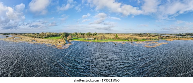Aerial panoramic view over Portumna Beach. Portumna Beach is an inland lake beach located at the head of Lough Derg on the River Shannon. Portumna, County Galway, Ireland.