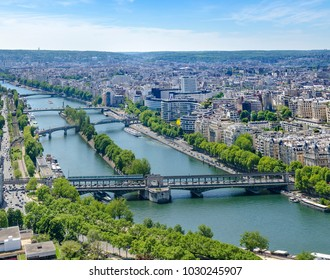 Aerial panoramic view of Paris cityscape with Seine river, Bir Hakeim bridge, island of Swans