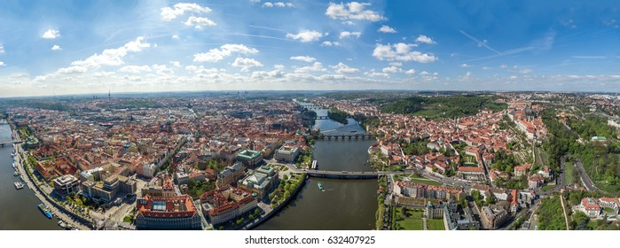 Aerial Panoramic View of Prague Cityscape in Czechia ( Czech Republic ) on a Beautiful Sunny Day feat City Central and Old Town with Vltava River, Bridges and Famous Landmarks such as Prague Castle