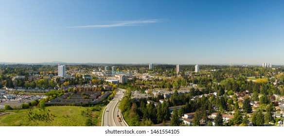 Aerial panoramic view of a residential neighborhood near Guildford Centre Mall during a sunny morning. Taken in Surrey, Vancouver, BC, Canada.