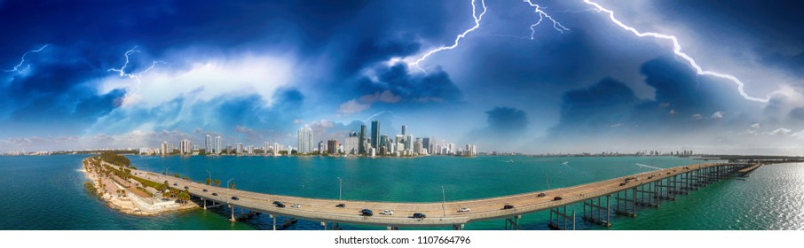 Aerial panoramic view of Rickenbacker Causeway and Miami skyline during a storm, Florida.