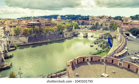 Aerial panoramic view of Rome from Castel Sant'Angelo in summer, Italy. Rome with Tiber River in the sunlight. Rome skyline. Beautiful scenic panorama of Rome on a sunny day. Vintage photo.