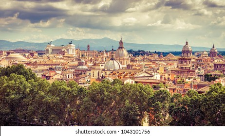 Aerial panoramic view of Rome, Italy. Rome skyline in summer. Old Rome in sunlight. Beautiful scenic panorama of Roma city from above. Scenery of historical area of Rome. Picturesque vintage photo.