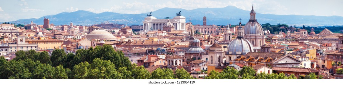Aerial panoramic view of Rome, Italy. Beautiful Rome skyline in summer. Scenic panorama of Roma city from above. Scenery of historical area of Rome in sunlight. Horizontal banner with Rome for web.