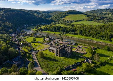 Aerial panoramic view of the ruins of Tintern Abbey, a Cistercian monastry located by the river Wye in South Wales, UK