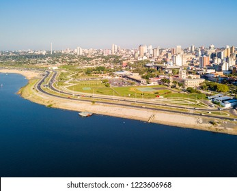 Aerial panoramic view of skyscrapers skyline of Latin American capital of Asuncion city, Paraguay on a sunny day. Embankment of Paraguay river. Ciudad de Asunción Paraguay. South America.
