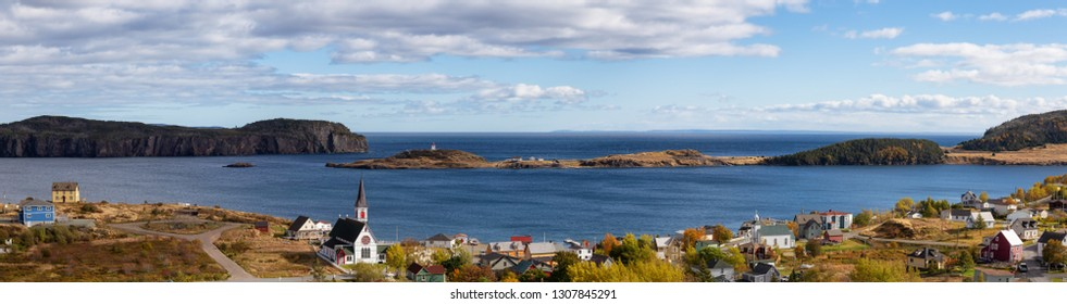Aerial panoramic view of a small town on the Atlantic Ocean Coast during a sunny day. Taken in Trinity, Newfoundland and Labrador, Canada.