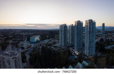 Aerial panoramic view of Surrey Central Mall in Greater Vancouver, British Columbia, Canada. Taken during a vibrant sunset.