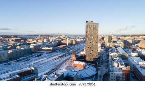Aerial panoramic view of Tampere city at winter, Finland. Tower hotel near the train station.