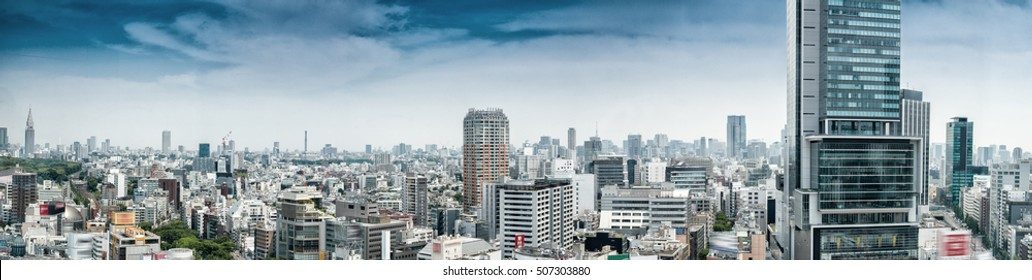 Aerial panoramic view of Tokyo buildings from Shibuya rooftop.
