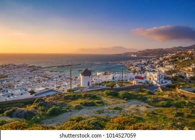 Aerial panoramic view of upper Chora in Mykonos, Greece at sunset. Colorful sunset over Mykonos, Cyclades, Greece