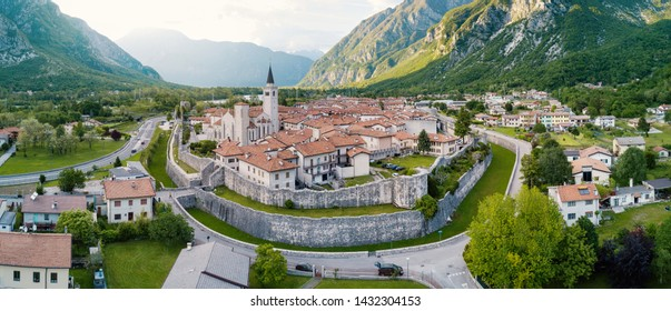 Aerial panoramic view of Venzone small city with its walls and cathedral in Northern Italy. It has been fully restored after the May 6th, 1976 earthquake.
