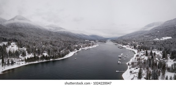 Aerial panoramic view of Winter Canadian Landscape. Taken in Balfour, near Nelson, Kootenay, British Columbia, Canada.