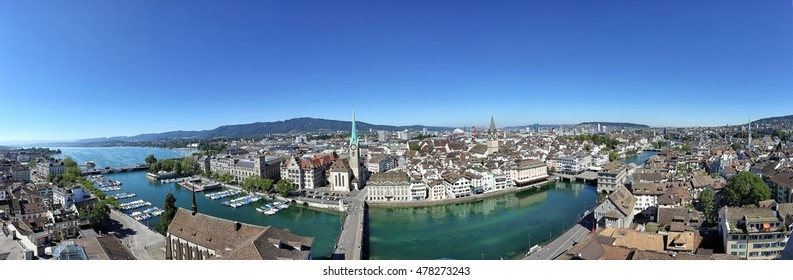 Aerial panoramic view of Zurich city with famous Fraumunster, St. Peter Church and river Limmat at Lake Zurich from Grossmunster Church on a sunny day with blue sky in summer, Switzerland