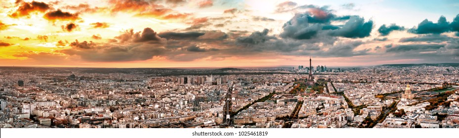 Aerial Paris view in late autumn at sunset. Eiffel Tower in the distance and financial district.