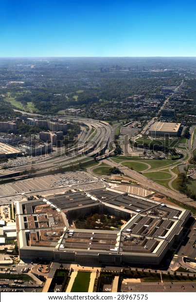 Aerial of the Pentagon, the Department of Defense headquarters in Arlington, Virginia, near Washington DC, with Interstate 395 on left and Air Force Memorial on right