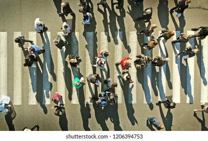 Aerial. People crowd on a pedestrian crosswalk.