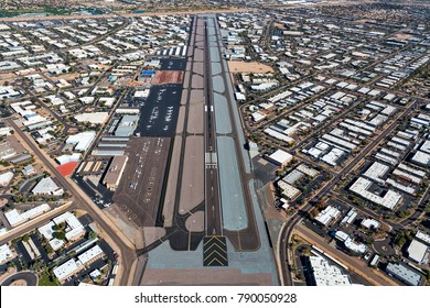 Aerial perspective of busy Scottsdale, Arizona airport and surrounding office and industrial buildings viewed from the southwest to the northeast