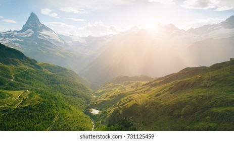 Aerial perspective of Matterhorn mountain in Swiss Alps at summer time at sunrise