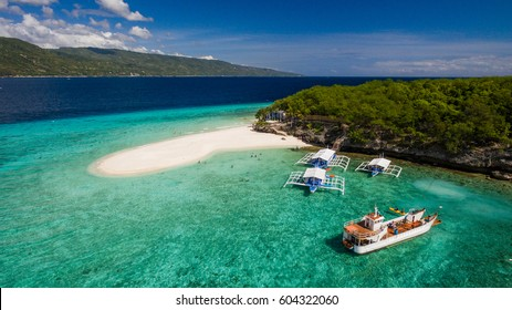 An aerial perspective of the Sumilon island beach landing near Oslob, Cebu, Philippines.